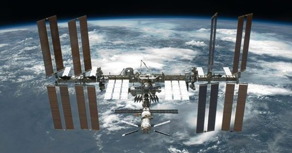 Astronauts Installing New Solar Panels to Boost the Orbital Outpost