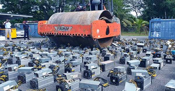 Watch a Steamroller Crush Over 1,000 Bitcoin Mining Rigs in Bizarre Police Video